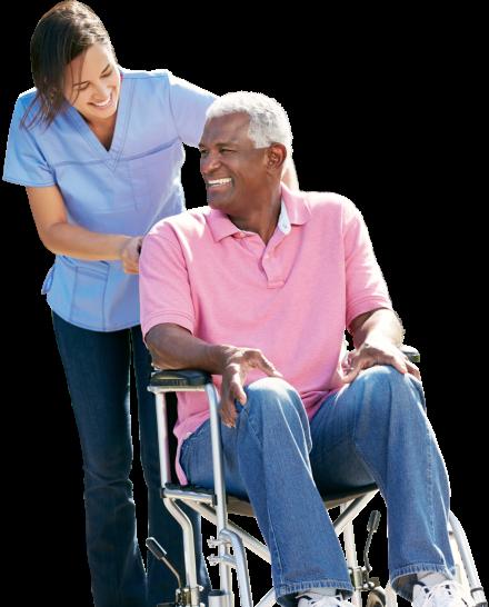 caregiver assisting senior man on wheelchair