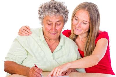 photo of an elderly woman writing